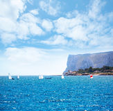 Sailboats Optimist learning to sail in Mediterranean at Denia Stock Photo