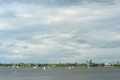 Sailboats on Outer Alster Lake Hamburg, joining in regattas or for relaxation outdoors. Sailboats on Outer Alster Lake Hamburg, Germany joining in regattas or Stock Photo