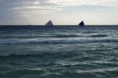 Sailboats over the rough sea Royalty Free Stock Photography