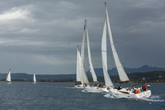 Sailboats participate in sailing regatta 12th Ellada Autumn 2014 among Greek island group in the Aegean Sea Royalty Free Stock Photos