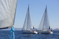 Sailboats participate in sailing regatta. Luxury yachts royalty free stock image