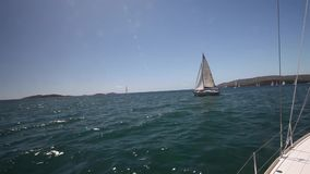 Sailboats participate in sailing regatta. Luxury. stock footage