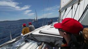 Sailboats participate in sailing regatta. Sailing. Yachting. stock footage