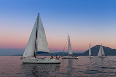 Sailboats participate in sailing regatta 12th Ellada Autumn 2014 among Greek island group in the Aegean Sea. PATRAS, GREECE - CIRCA OCT, 2014: Unidentified royalty free stock photos