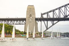 Sailboats performing ballet movement show in events on Australia day at Sydney Harbour. stock image