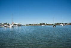Sailboats in Port Denarau Harbour. PORT DENARAU,FIJI-NOVEMBER 27,2016: Harbour waterfront with anchored sailboats and catamarans in the Pacific Ocean waters in Stock Photography