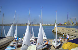 Sailboats preparation on quay Royalty Free Stock Photos