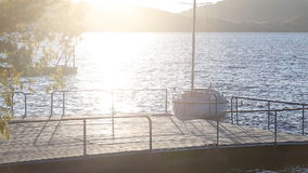 Sailboats in a quiet harbor stock video footage