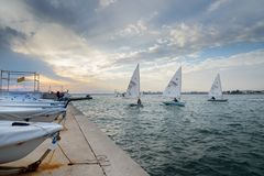 Sailboats race in Roses leisure port royalty free stock photography