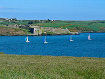 Sailboats Racing Past Charles Fort Stock Photography