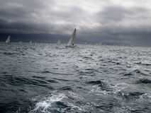 Sailboats in regatta. Photo taked during the Route of the Salt (Ruta de la sal) between Denia and Ibiza competing against sailboats for a trophy Stock Image