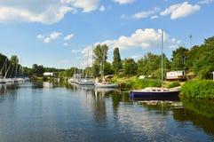 Sailboats river landscape. Sailboats marina, river landscape with sky reflection stock image
