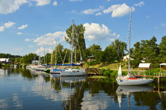 Sailboats river landscape. Sailboats marina, river landscape with sky reflection Royalty Free Stock Image