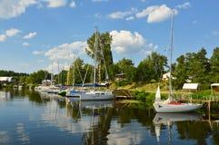 Sailboats river landscape. Sailboats marina, river landscape with sky reflection royalty free stock image