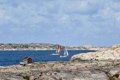 Sailboats at rocky coast Royalty Free Stock Photography