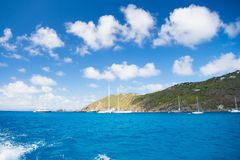 Sailboats sail in sea on cloudy blue sky in gustavia, st.barts. Sailing and yachting adventure. Summer vacation on tropical island Stock Photos