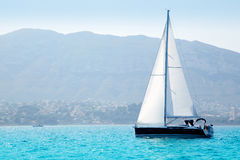 Sailboats sailing in mediterranean sea Royalty Free Stock Images