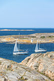 Sailboats sailing in rocky archipelago Stock Photography