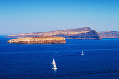 Sailboats at Santorini island's caldera Stock Images