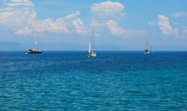 Sailboats at sea. Sailboat sailing in the morning with blue cloudy sky Royalty Free Stock Photos