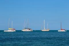 Sailboats on the sea. Sailboats moor on the sea Stock Image