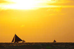 Sailboats on the sea under  sunset Stock Photography