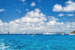 Sailboats, ship and boat sail in blue sea on cloudy sky in gustavia, st.barts. Sailing and yachting adventure. Summer vacation on Stock Photography