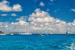 Sailboats, ship and boat sail in blue sea on cloudy sky in gustavia, st.barts. Sailing and yachting adventure. Summer. Vacation on tropical island. Water stock image
