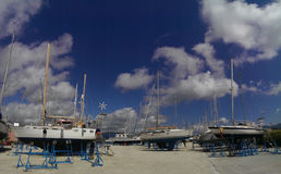 Sailboats in ship yard Royalty Free Stock Photo