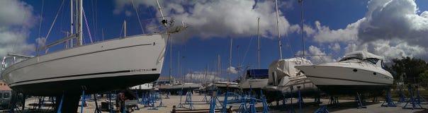 Sailboats in shipyard Royalty Free Stock Image