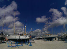 Sailboats in a shipyard Stock Images