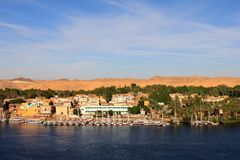 Sailboats sliding on Nile river. Felluca (traditional boat) of Egypt in Aswan's sunset Royalty Free Stock Photos