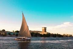 Sailboats sliding on Nile river. Felluca (traditional boat) of Egypt in Aswan's sunset Stock Image