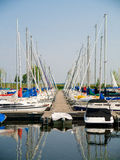 Sailboats in slips at dock Stock Photography