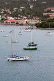 Sailboats in St Thomas Bay with Resorts Royalty Free Stock Image