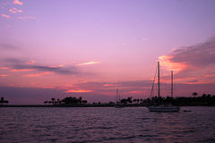 Sailboats at sunrise Stock Photos