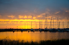 Sailboats in sunset Stock Images
