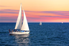 Sailboats at sunset Stock Photography