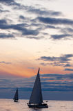 Sailboats at sunset, calm autumn weather. In ocean Royalty Free Stock Photography