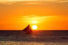 Sailboats at sunset on a tropical sea. Silhouette photo. Royalty Free Stock Photo