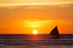 Sailboats at sunset on a tropical sea. Silhouette photo. Stock Images