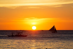 Sailboats at sunset on a tropical sea. Silhouette photo. Royalty Free Stock Images