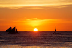 Sailboats at sunset on a tropical sea. Silhouette photo. Royalty Free Stock Photography