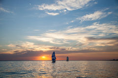 Sailboats at sunset. Two sailboats at sunset. Waterlife royalty free stock images