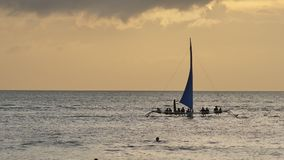 Sailboats with tourists at sunset on the island of Boracay. Philippine Tropics. Recreation. Tourism. Sailboats with tourists at sunset on the island of Boracay stock footage