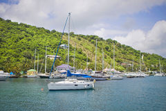 Sailboats in the tropics. Large and luxurious sailboats anchored next to a beautiful tropical island Stock Images