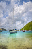 Sailboats in the tropics. Beautiful tropical cove filled with anchored luxurious sailboats Stock Photography