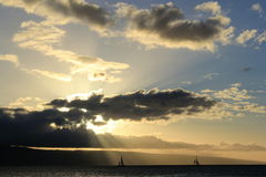 Sailboats. Two sailboats drifting by in the beautiful sunbeam stock image