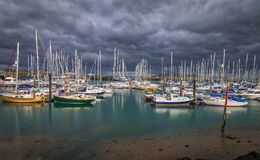 Bay of Howth. Sailboats staying put as a storm rolls in over Bay of Howth in Ireland Stock Photos