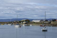 Sailboats in Ushuaia Harbor with the airport in the background Royalty Free Stock Photography